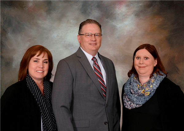 Superintendent Brian Coleman, Human Resources Coordinator Caryn Sturz and Michelle Nickleski, Executive Assistant to The Supe